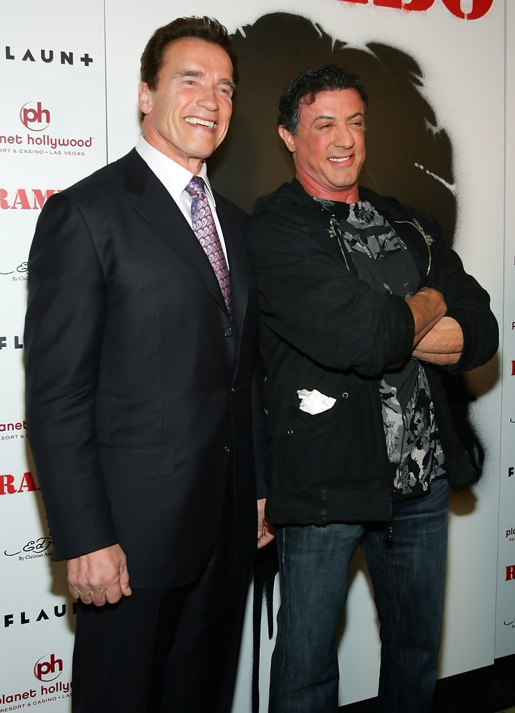 Arnold Schwarzenegger and Sylvester Stallone at the world movie premiere of Rambo